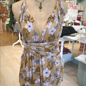 Wear any way romper. Boutique item. Size small